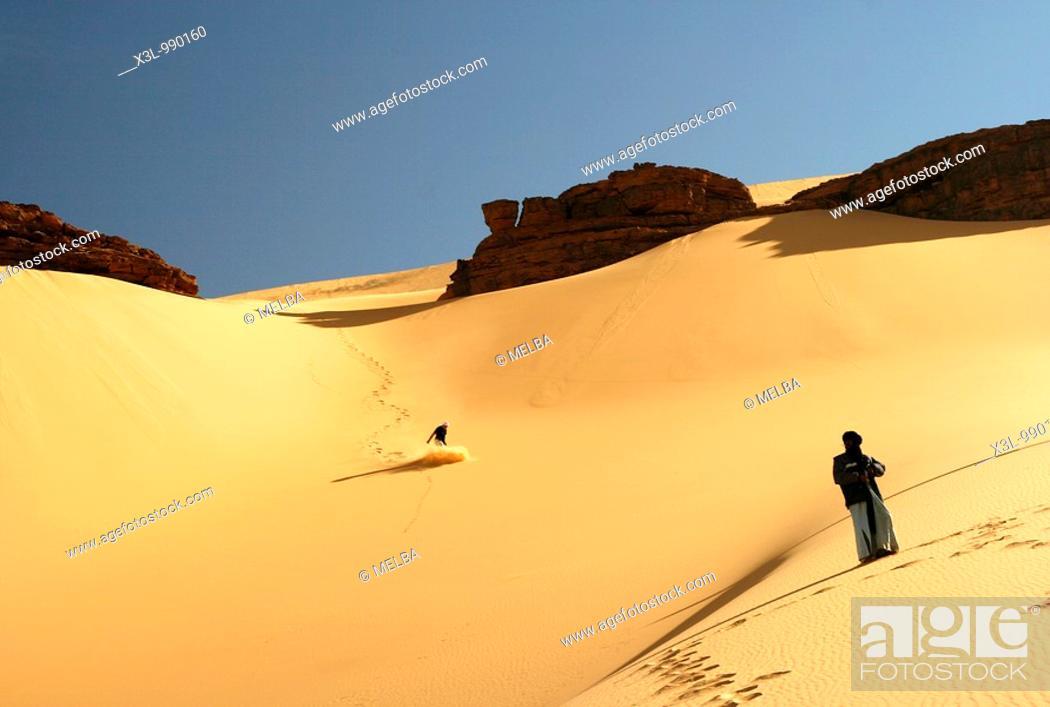 Stock Photo: Touareg look at tourist slipping in dune  Oued Tin Tarabine Tassili Ahaggar  Sahara desert  Algeria.