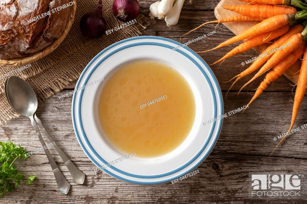 Stock Photo: Chicken bone broth with fresh vegetables, top view.