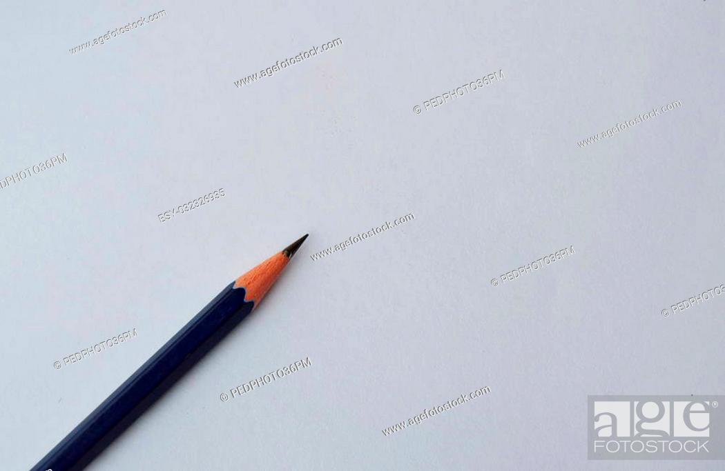Stock Photo: pencil on white paper.