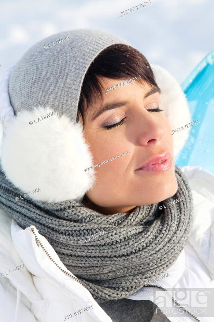 Stock Photo: Young woman in winter clothes resting.