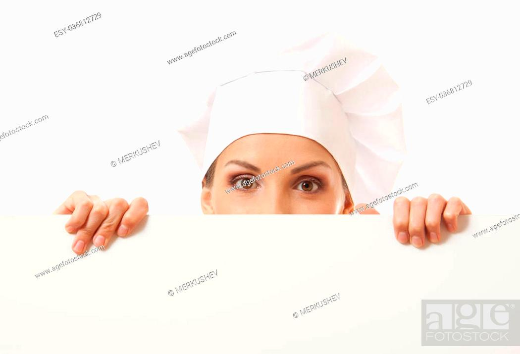 Stock Photo: Woman cook looking over paper sign billboard. Isolated on white.