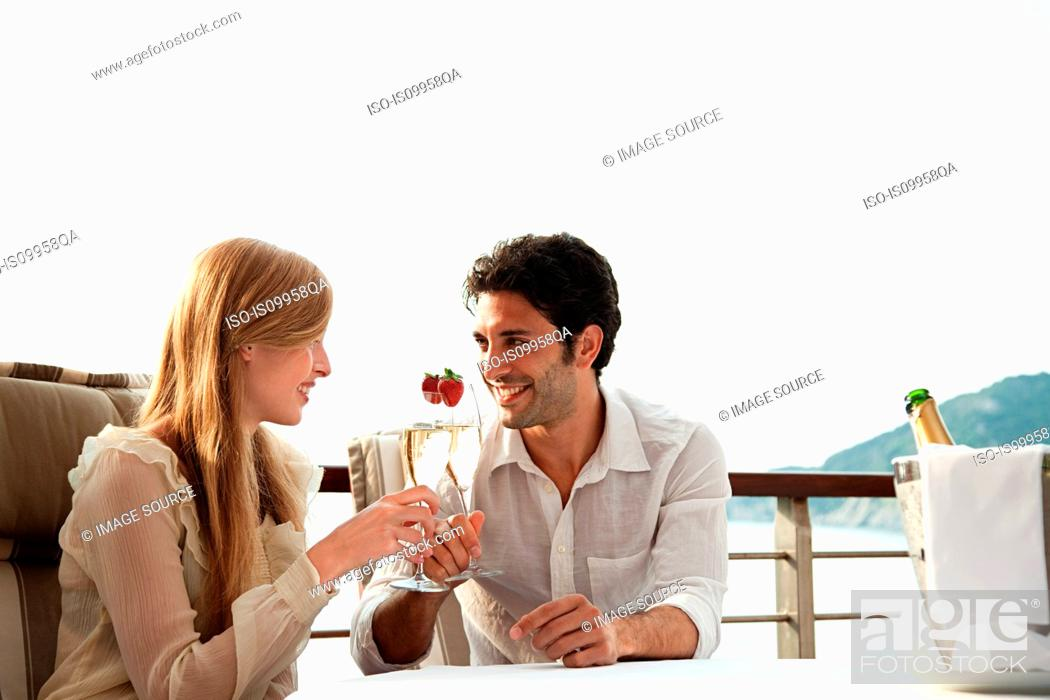 Stock Photo: Young couple toasting with champagne.