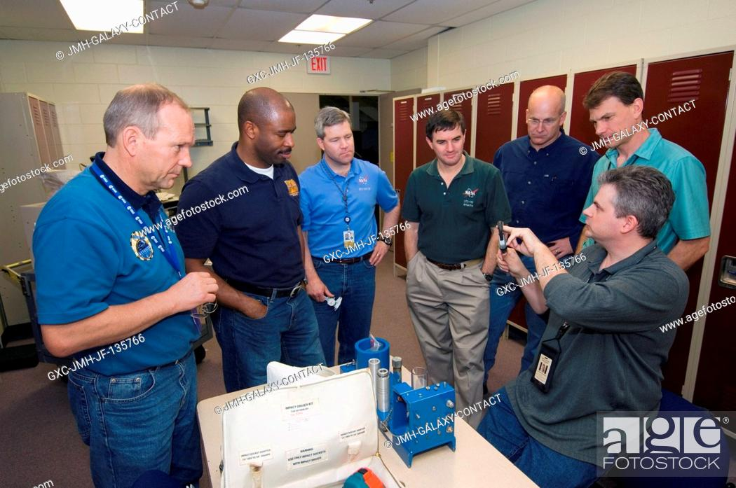 Stock Photo: The STS-122 crewmembers participate in a tool training session in the Space Vehicle Mockup Facility at the Johnson Space Center.