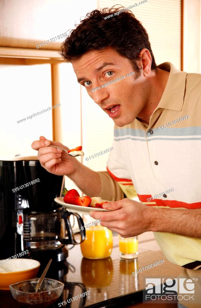 Stock Photo: Man eating his breakfast.