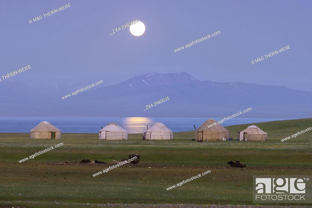 Stock Photo: Moon rising over Song Kol lake and nomads Yurts, Naryn province, Kyrgyzstan, Central Asia.