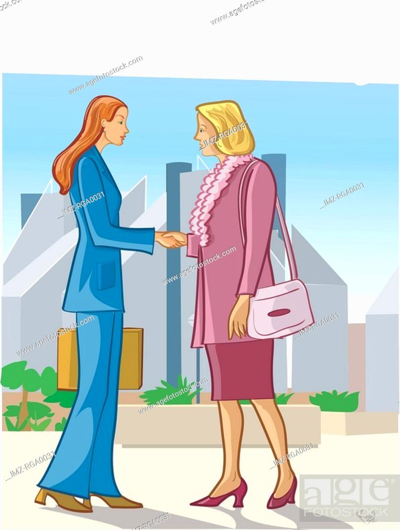 Stock Photo: Two businesswomen shaking hands on a street.