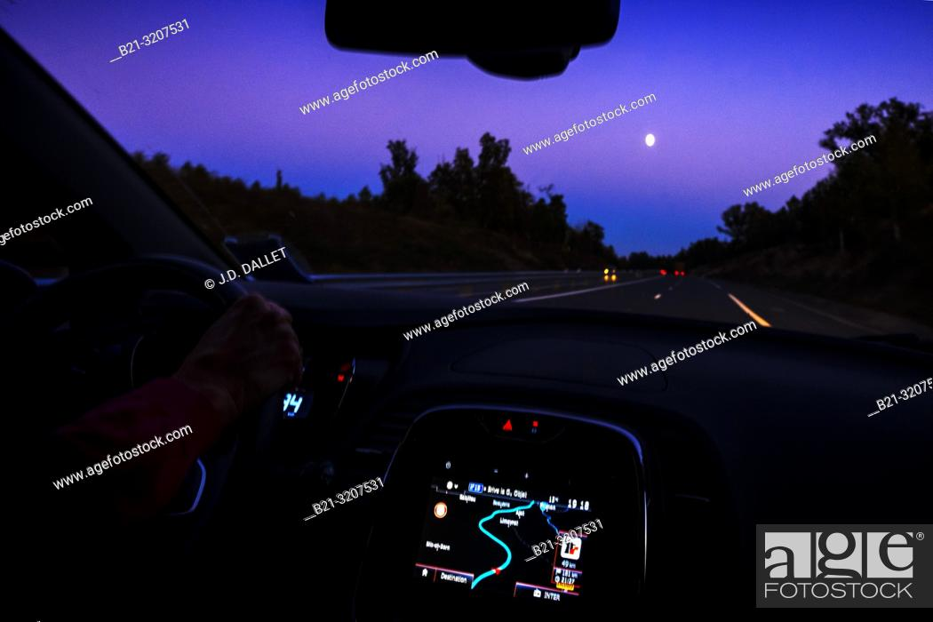 Imagen: France, Occitanie, Lot, driving on a land roa, by night, near Figeac.