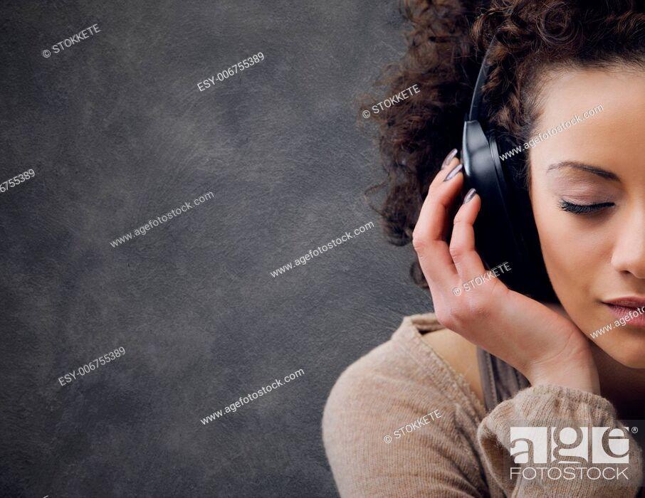 Stock Photo: young beautiful woman enjoying music.