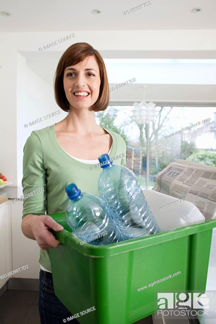 Stock Photo: Woman doing recycling.
