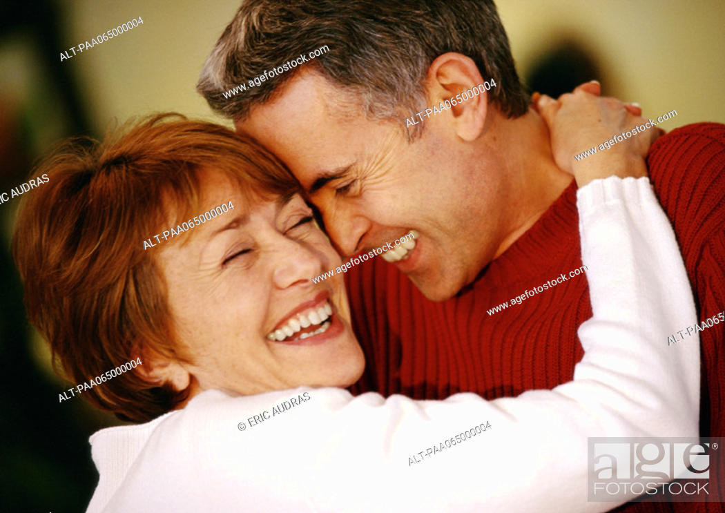 Stock Photo: Man and woman hugging, smiling, close up.