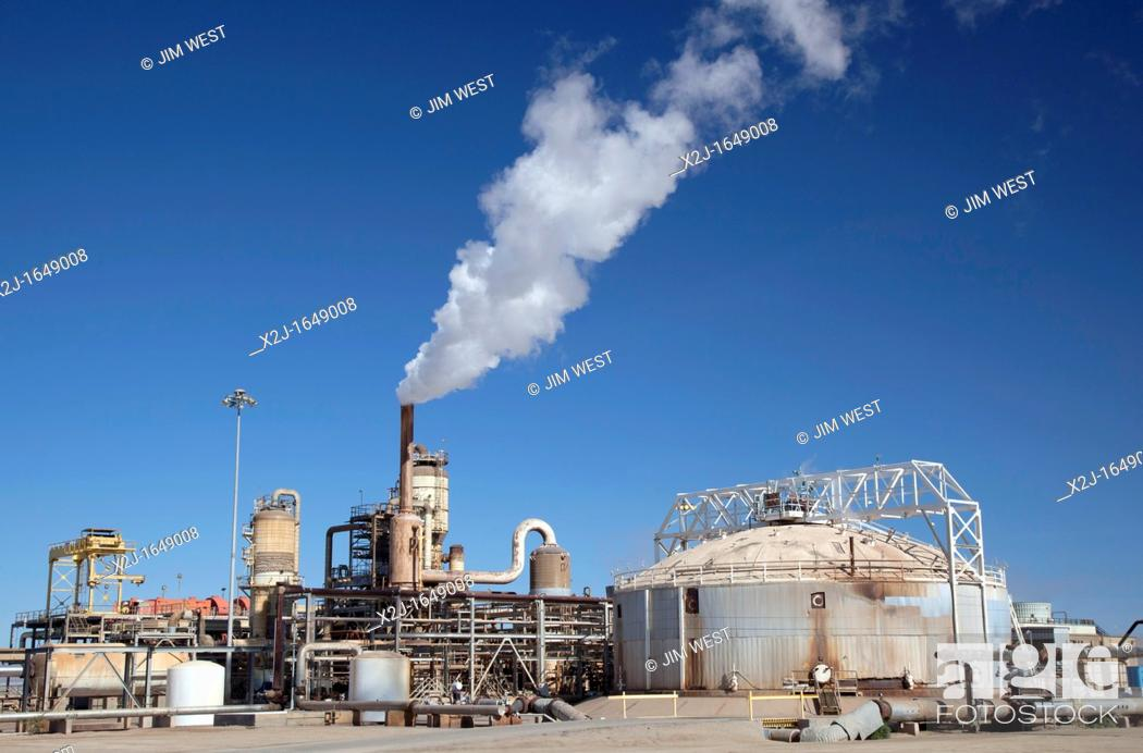 Stock Photo: Calipatria, California - A geothermal energy plant operated by CalEnergy in California's Imperial Valley  The pipes carry hot water or steam from deep.
