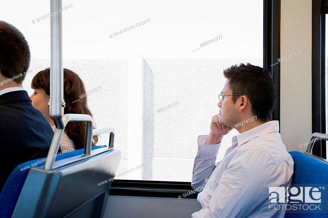 Stock Photo: People on train.