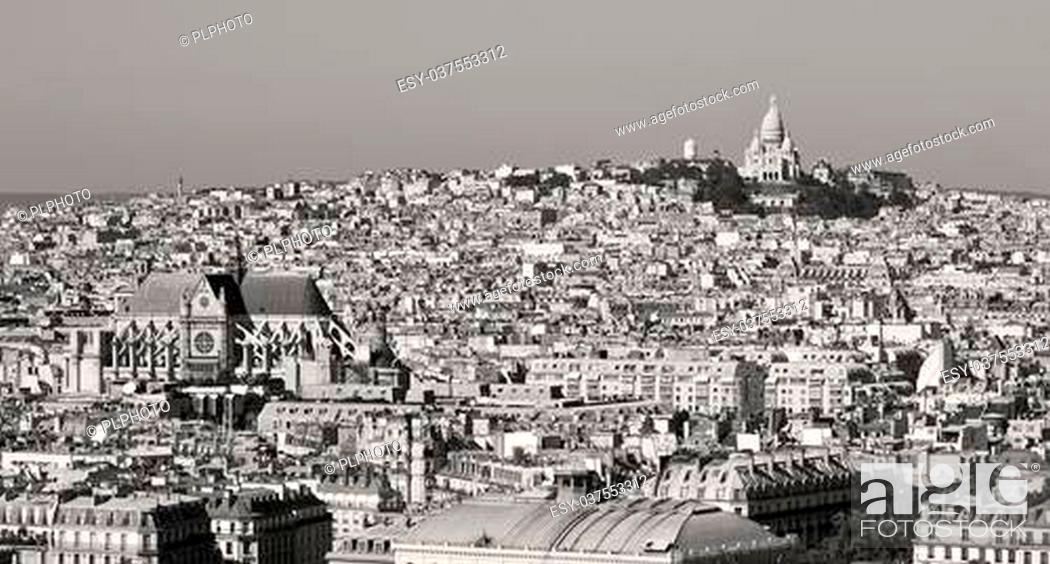 Stock Photo: butte montmartre with sacred heart at the summit, Paris city, france.