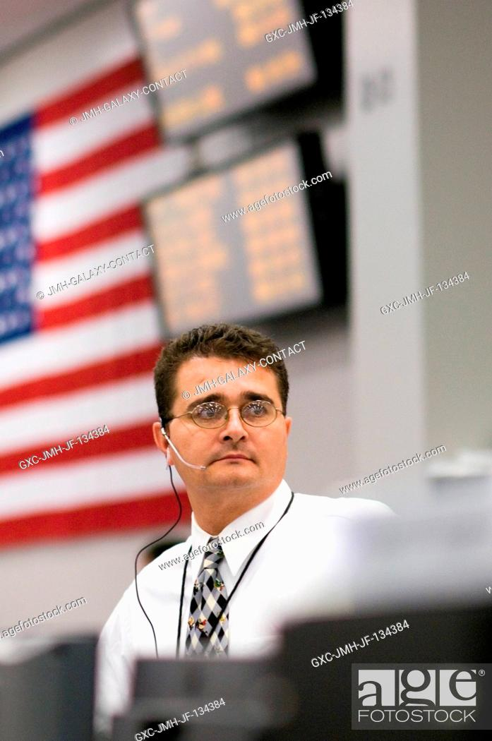 Stock Photo: William F. (Bill) Lane at the BOOSTER console in the Shuttle (White) Flight Control Room joins dozens of other flight controllers in Houston's Mission Control.