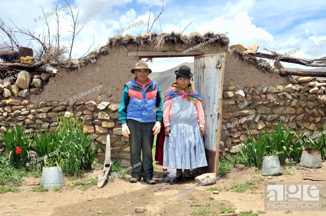 Stock Photo: Portrait of two elderly people, couple, in a yard gate, Bolivian Altiplano highlands, Departamento Oruro, Bolivia, South America.