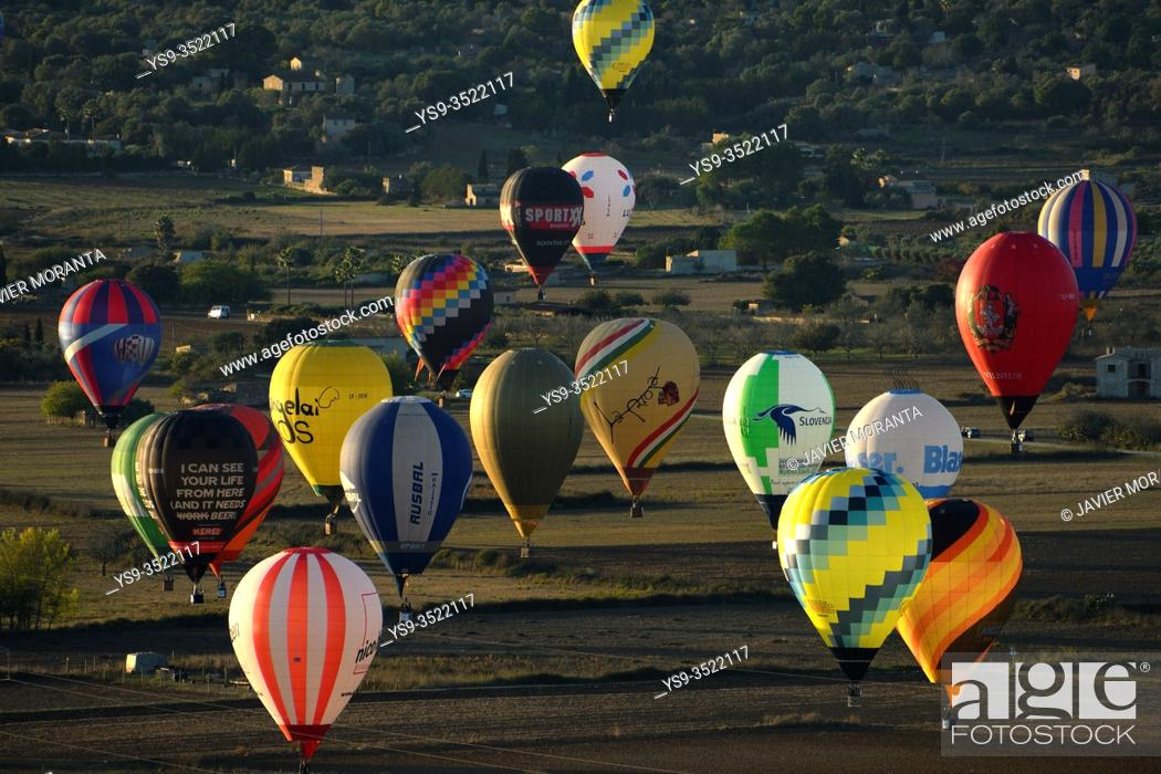Stock Photo: Hot air balloons in flight participating in the XXI FAI Europeans hot air balloon championship 2019, Spain, Balearic Islands, Mallorca.
