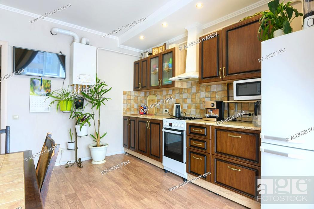 Stock Photo: Kitchen set in a spacious living room and kitchen with an old classic wood design.