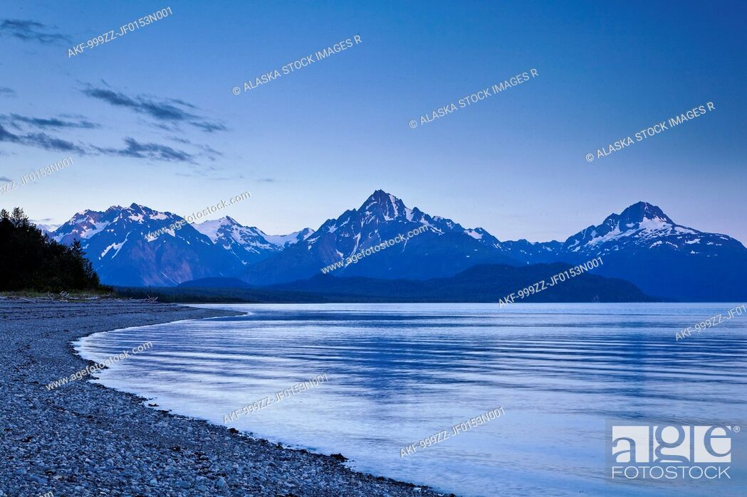 Stock Photo: View of Mount Wright seen from Goose Cove at dusk, Glacier Bay National Park & Preserve, Southeast Alaska, Summer.