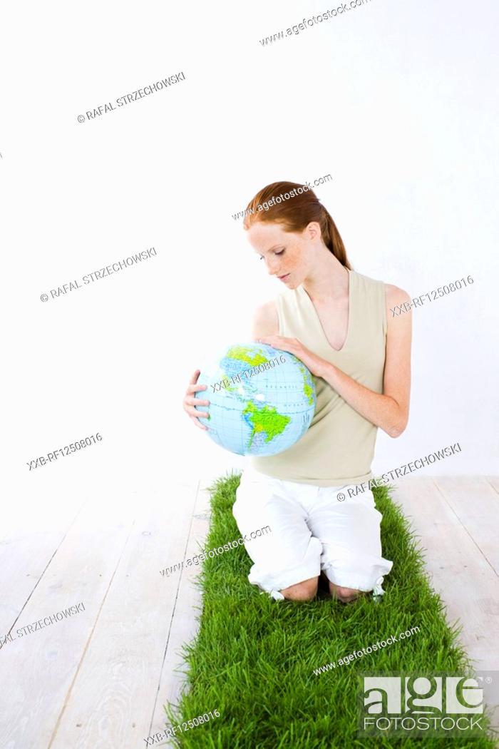 Stock Photo: woman watching globe.