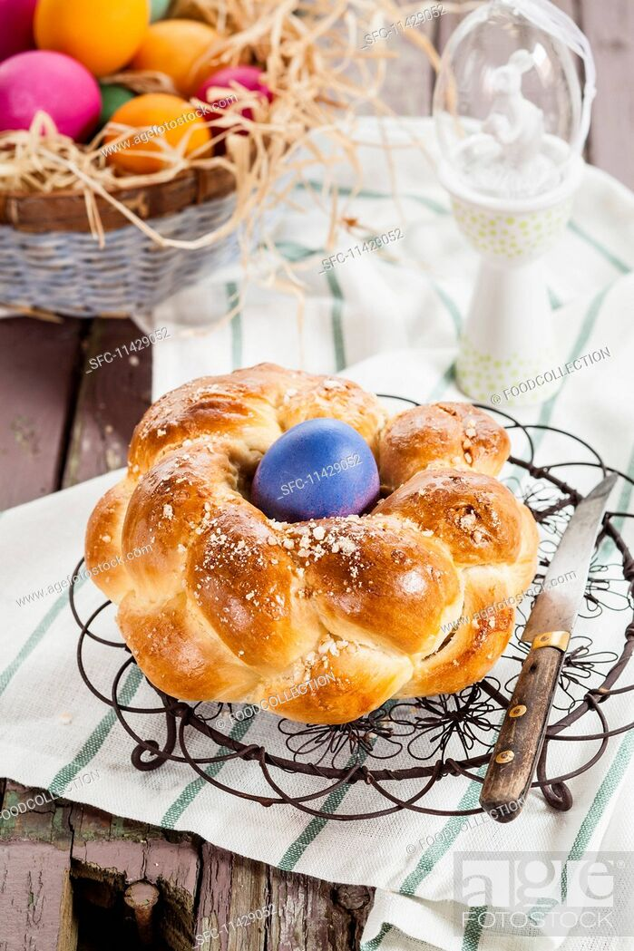 Stock Photo: A traditional Easter nest bread with an Easter egg.