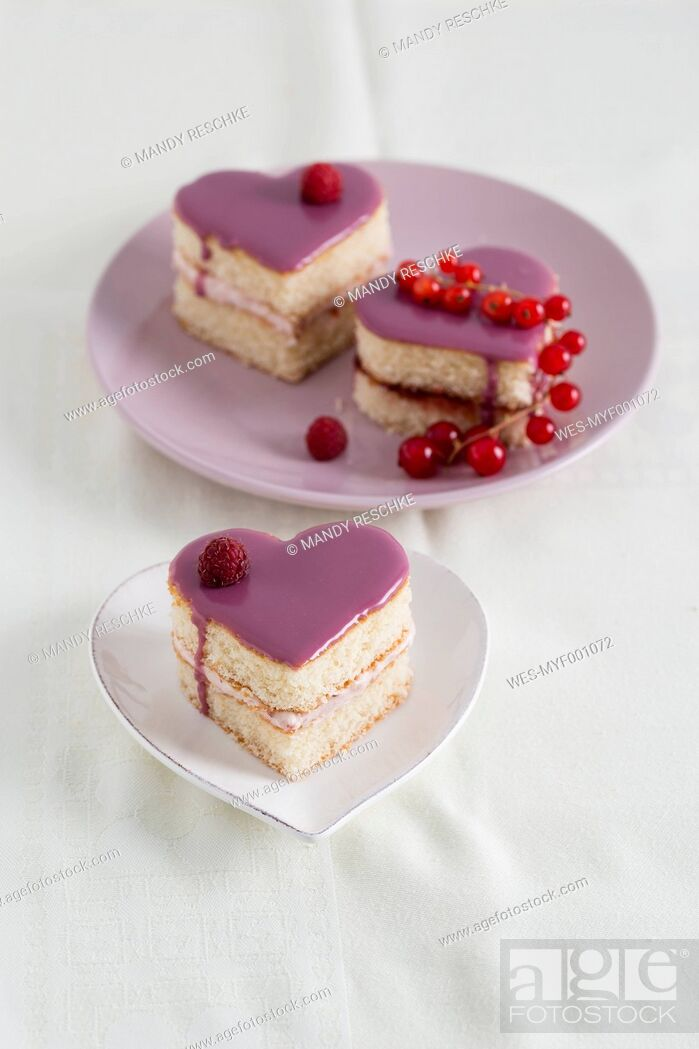 Stock Photo: Small biscuit cakes in heart shape with raspberry cream and currant jelly.