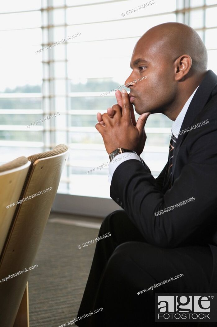 Stock Photo: African businessman thinking.