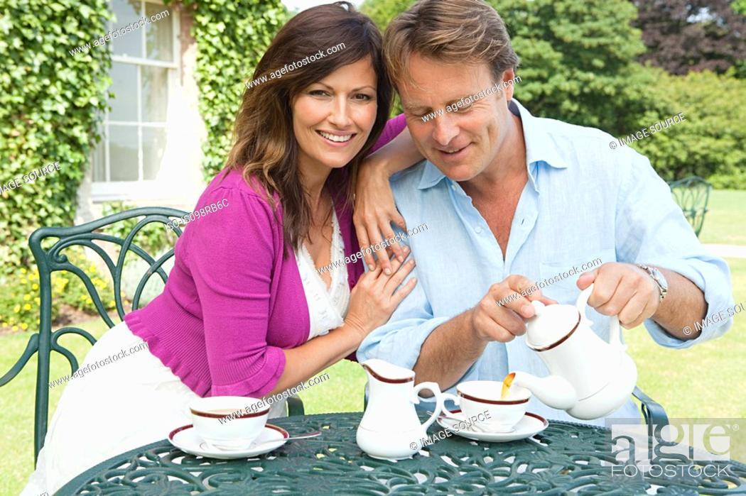 Stock Photo: Couple having tea outdoors.