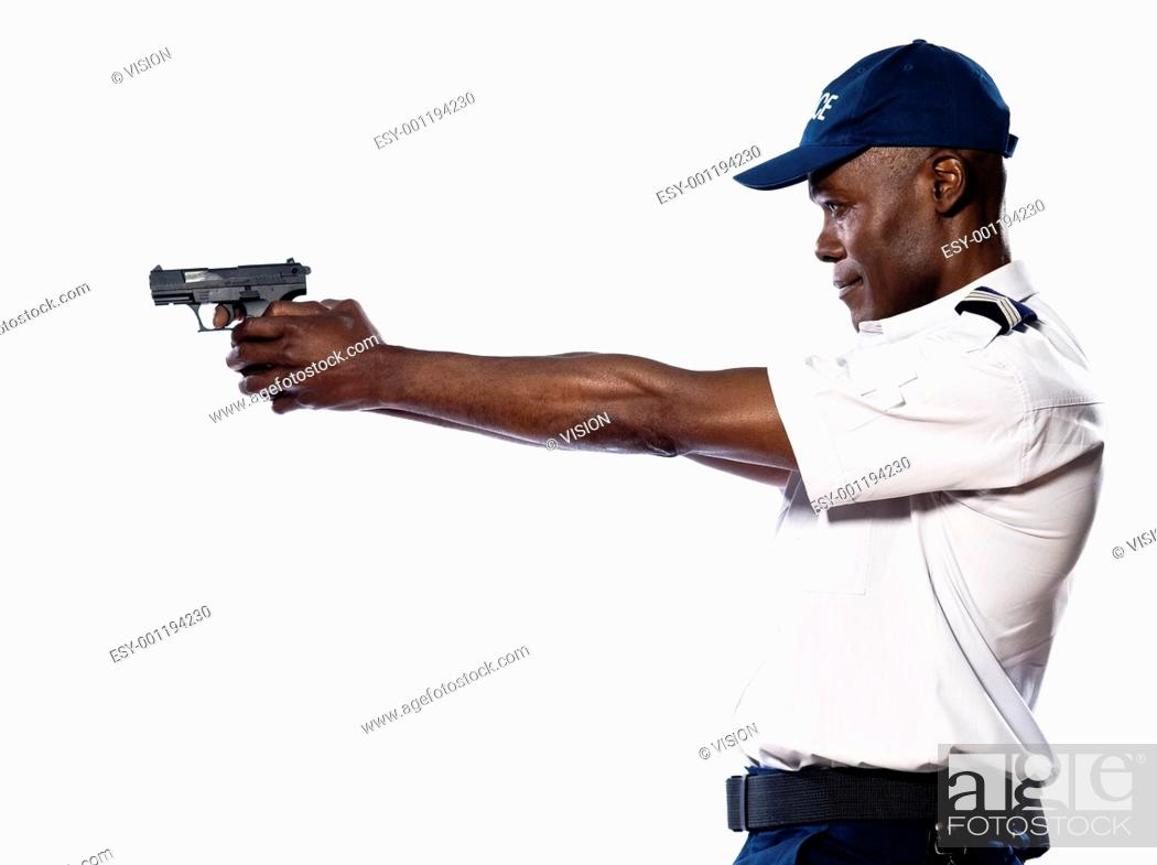 Stock Photo: Side view of an afro American police officer aiming gun in studio on white isolated background.