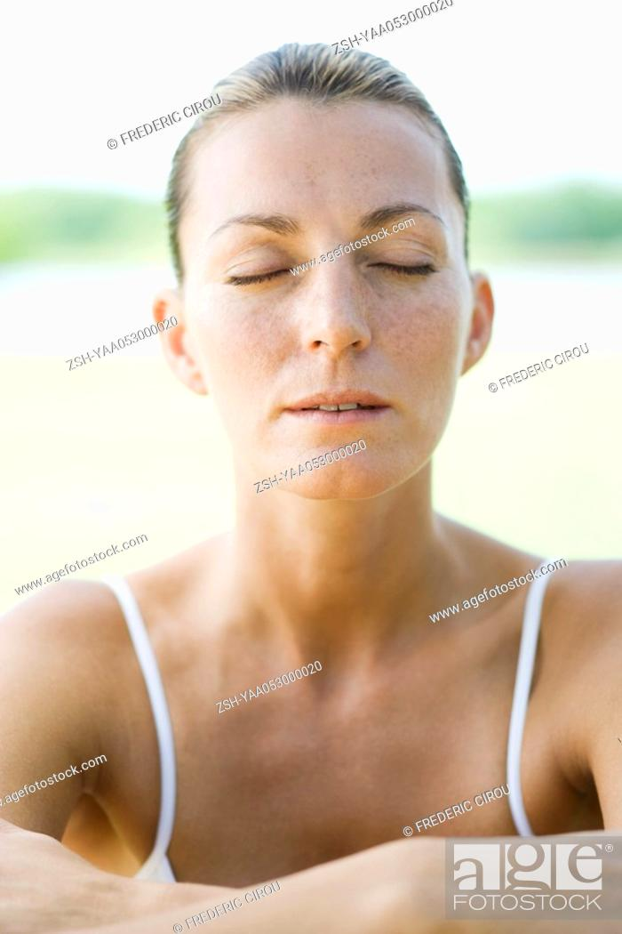 Stock Photo: Woman with eyes shut, portrait.