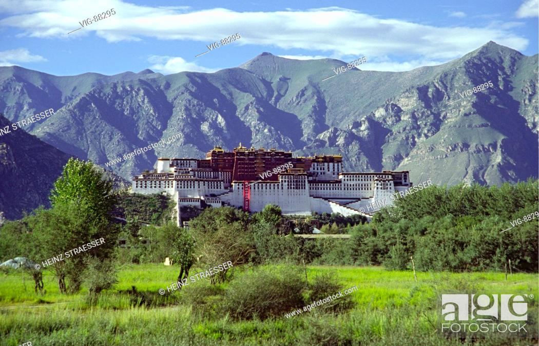 Stock Photo: The Potala, on top of a mountain ridge. In the center the Red Palace (Potrang Marpo), the real palace of the Dalai Lamas.