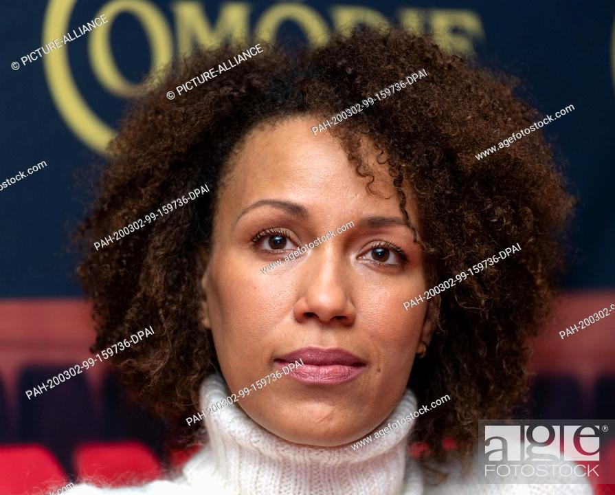 """Stock Photo: 02 March 2020, Saxony, Dresden: Actress Dominique Siassia sits on the podium at a press event of Comödie Dresden for the German premiere of """"""""Sternstunden""""""""."""