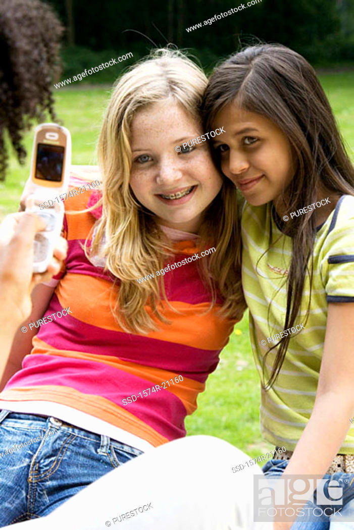 Stock Photo: Close-up of two girls posing for a mobile camera.