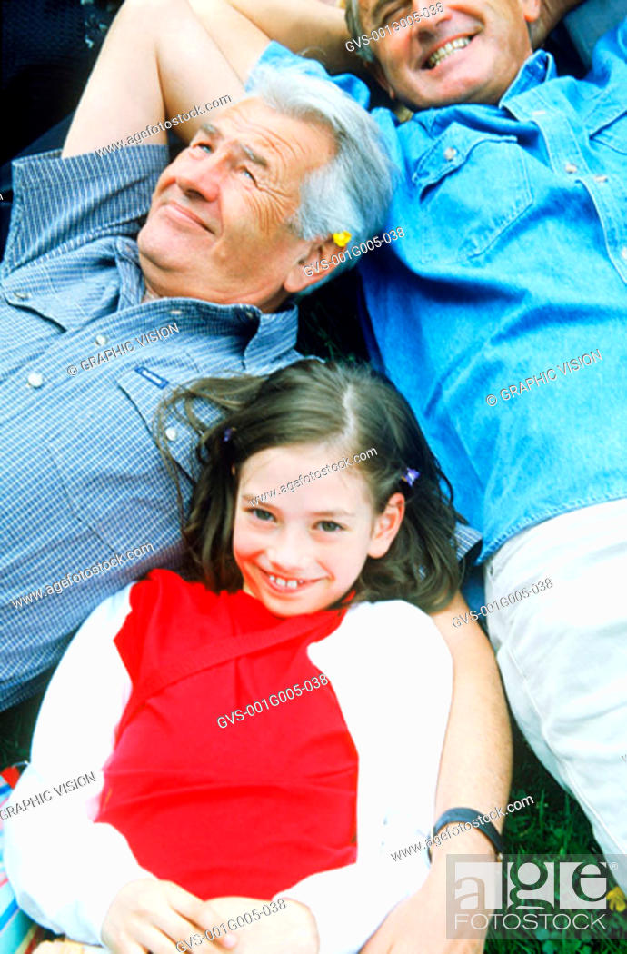 Stock Photo: Two senior men with a young girl.