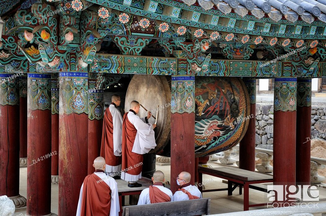Stock Photo: Drum ceremony performed by monks before the evening prayer at the buddhist temple of Haeinsa. South Korea, South Gyeongsang Province (Gyeongsangnam-do), Gayasan.