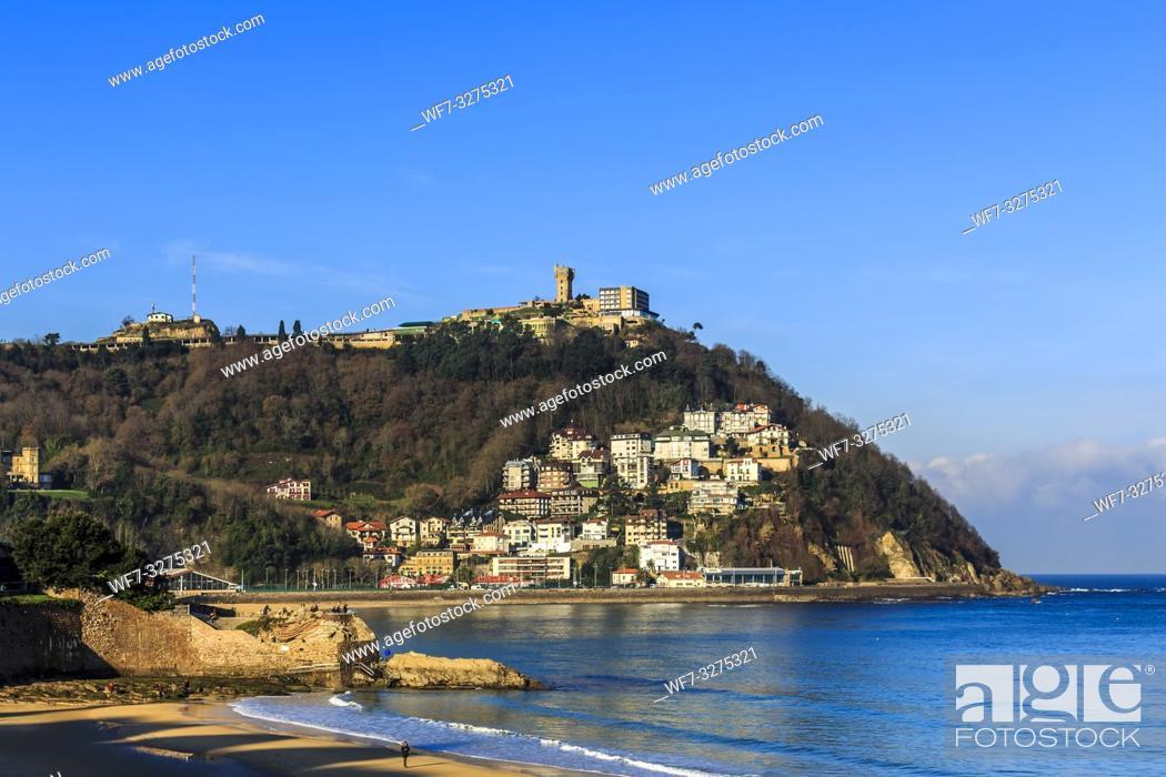 Stock Photo: San Sebastian, Spain - Jan 2019: Pico Del Loro (Parrot's Beak) and in the distance houses and apartments on Igeldo mountain range.