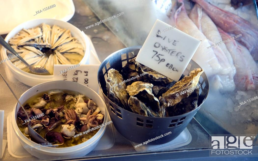 Stock Photo: Fresh shellfish and live oysters in fishmonger shop display, Scarborough, Yorkshire, England.