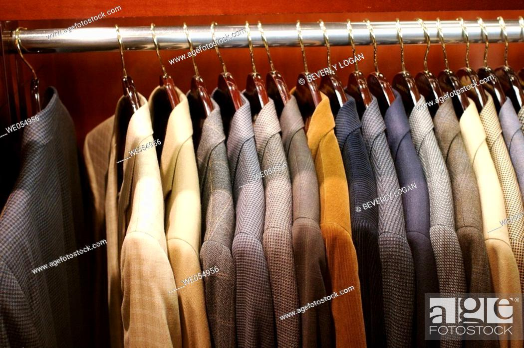 Stock Photo: Men's sports jackets on a rack in a department store.