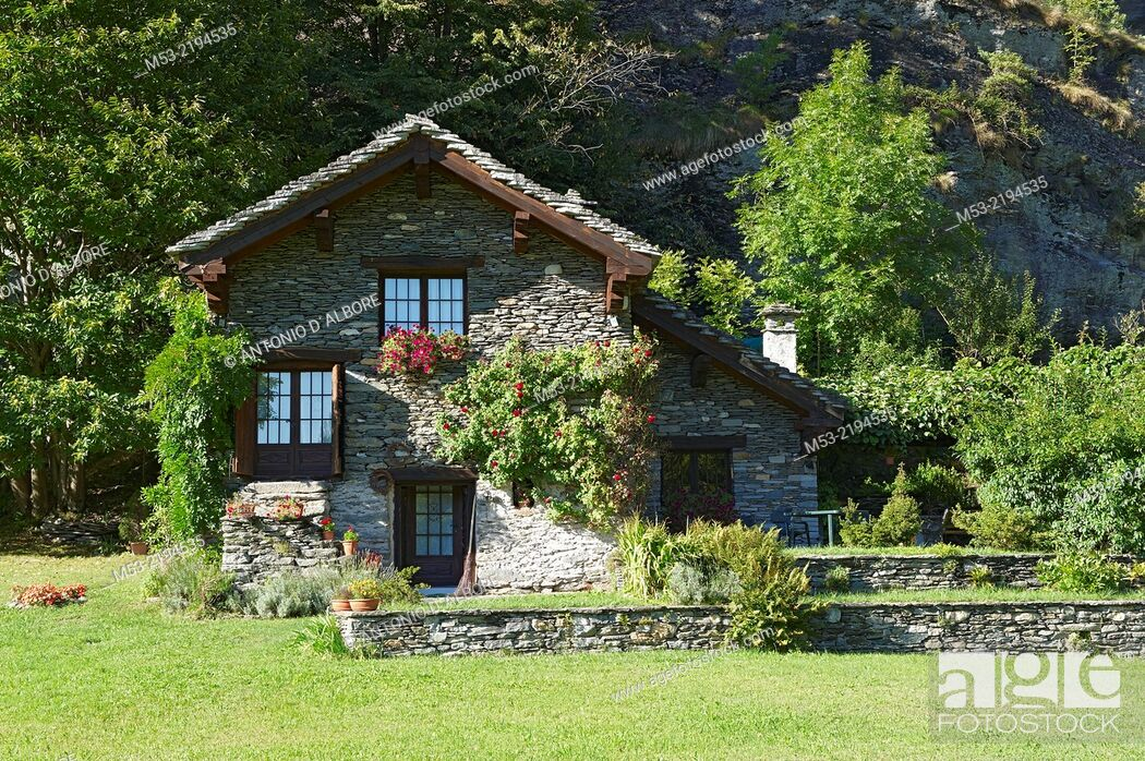 Stock Photo: Alpine building made of rocks and decorated with plants and flowers. antigorio valley. piemonte. italy. europe.