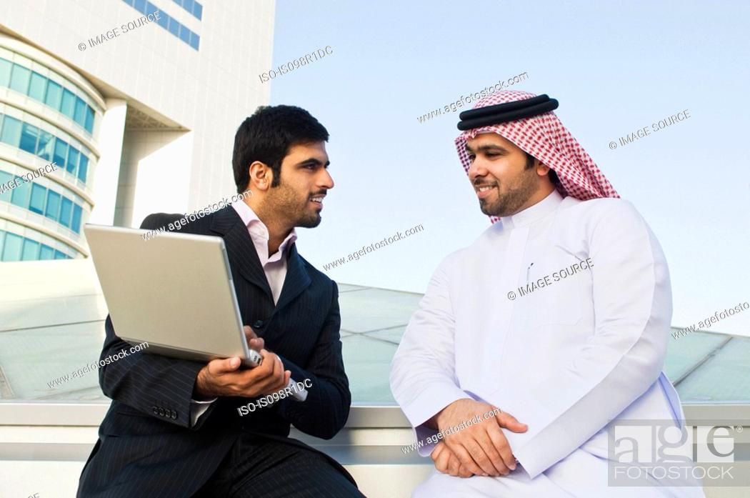 Stock Photo: Two businessmen talking.