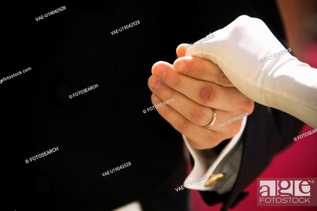 Stock Photo: holding, human hands, mid section.