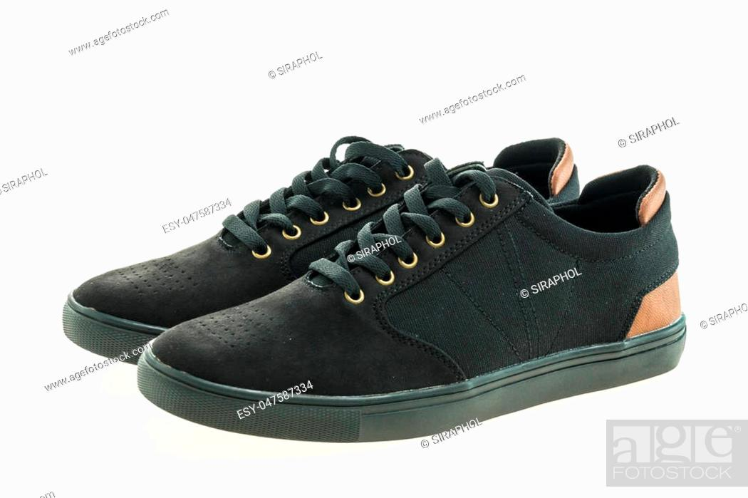 Stock Photo: Beautiful black leather shoes for men isolated on white background.