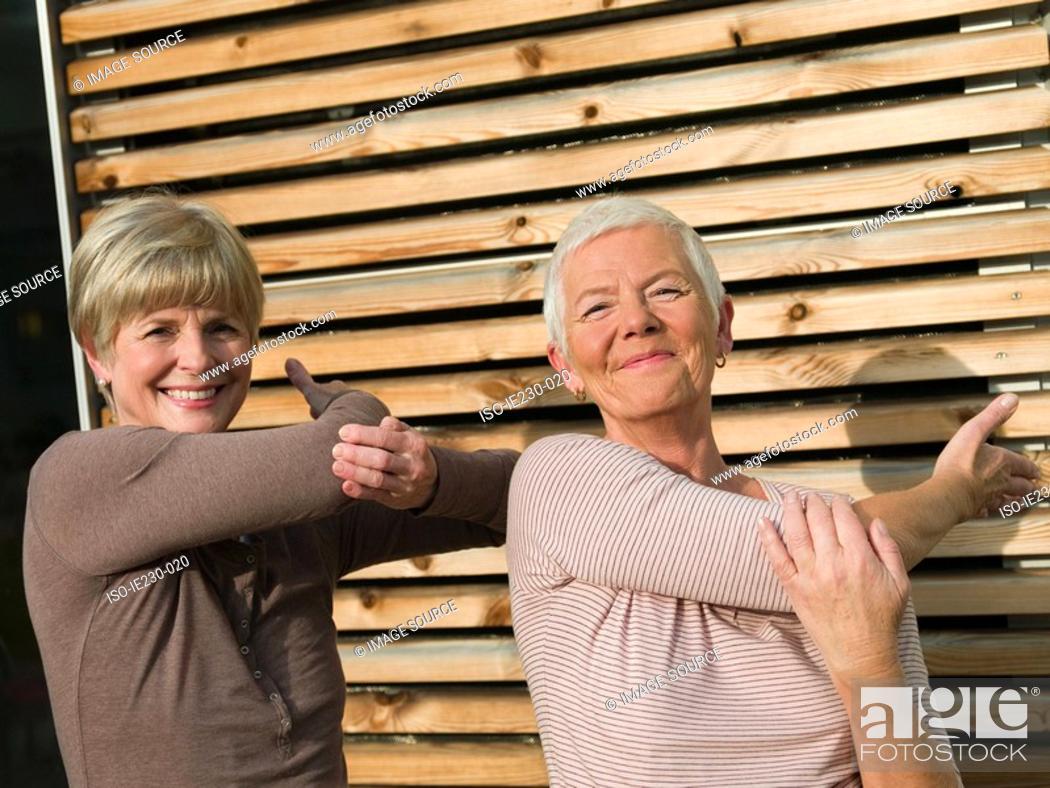 Stock Photo: Senior women doing tai chi.
