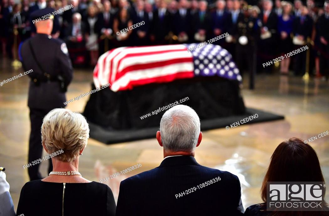 Stock Photo: Vice President Mike Pence (C) his wife Karen (R) and City McCain, the widow of Sen. John McCain, R-Ariz., stand during McCain's memorial service in the Capitol.