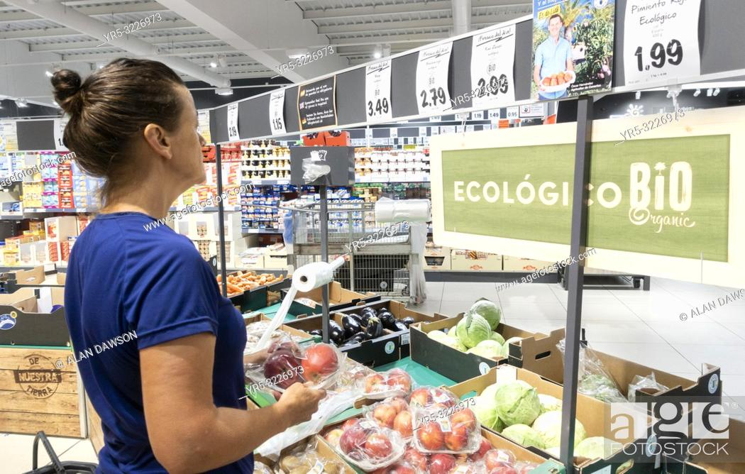 Stock Photo: Woman buying fruit in Lidl supermarket on Gran Canaria, Canary Islands, Spain. Model released.