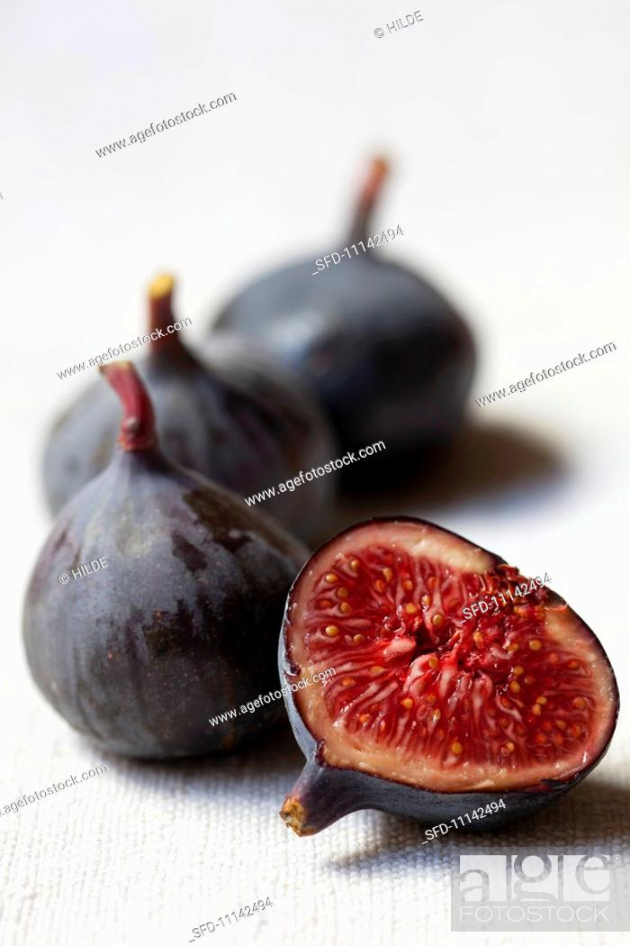 Stock Photo: Figs, whole and halved.