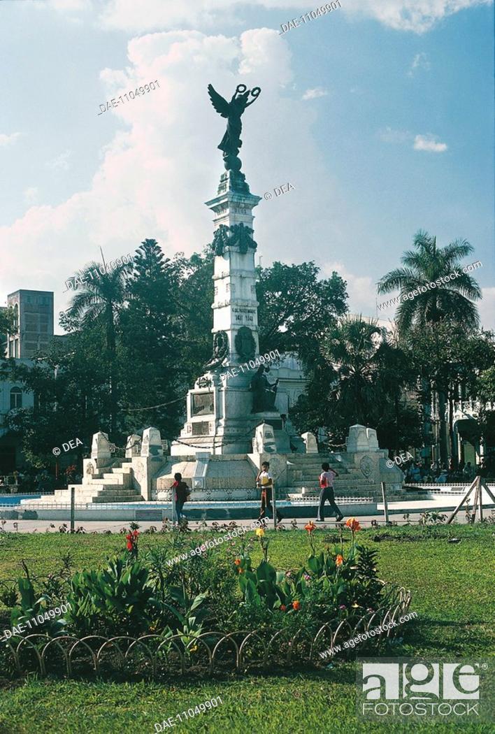 Stock Photo: Three people in front of a statue El Salvador - San Salvador.