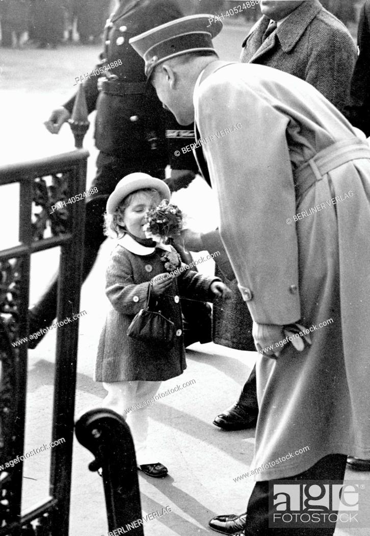 db5cae46e Stock Photo - The image from the Nazi Propaganda! shows Adolf Hitler  receiving flowers from a little girl on his way to a reception at the  Ministry of ...