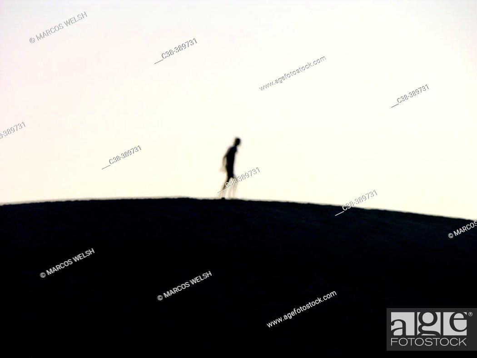 Stock Photo: small planet, big man.