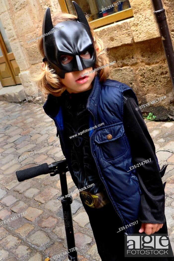 A Young Girl Wears A Batgirl Costume Stock Photo Picture And