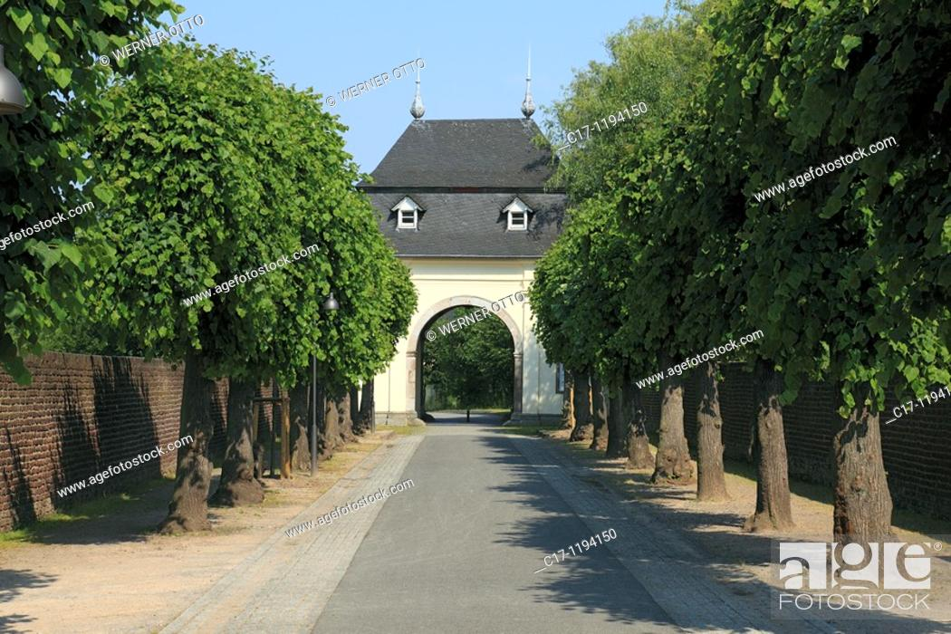 Stock Photo: Germany, Dormagen, North Rhine-Westphalia, Dormagen-Delhoven, monastery Knechtsteden, premonstratensian abbey, Spiritans Order, convent wall, archway, trees.